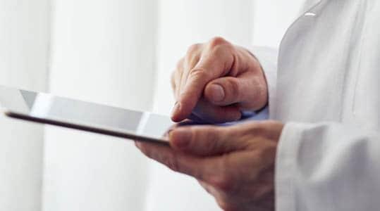 Medical professional using an iPad